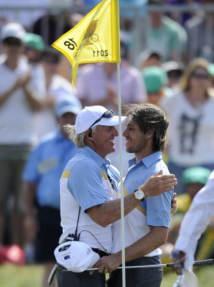 Australia's captain Greg Norman, left, congratulates Aaron Baddeley. 