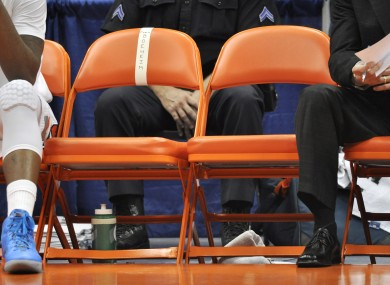 The empty chairs of Syracuse head coach Jim Boeheim and associate head coach Bernie Fine during a game last weekend.
