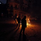 Protesters start a fire during clashes with Egyptian riot police near Tahrir Square. (AP Photo/Khalil Hamra/PA Images)
