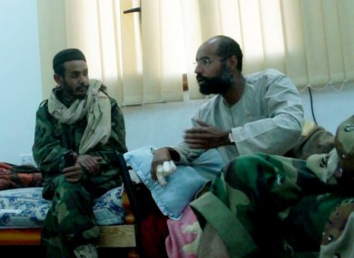 Video still of Seif al-Islam Gaddafi, left, after his capture.