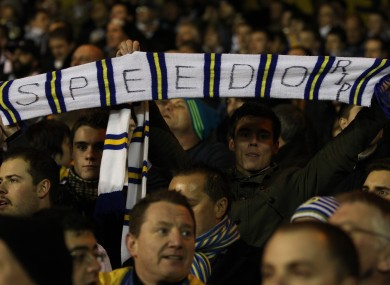 Leeds United fans hold up a scalf in memory of Gary Speed last night at the City Ground.
