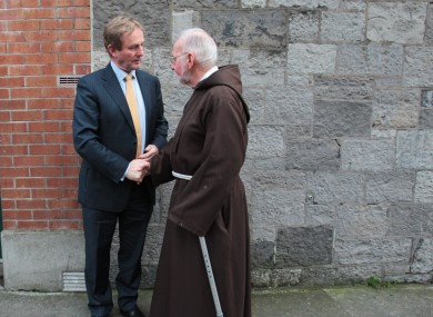 The Taoiseach with Brother Kevin Crowley from the Capuchin Day centre in Smithfield, Dublin yesterday.