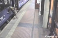 Video: Drunk woman falls between train and platform