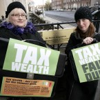 The 'Claiming Our Future' group held a protest this morning outside the Department of Finance where they were asking the Government to 'Tax Wealth: Fair Dues'. Pictured at the protest are Sandra Stapleton, left, and Siobhan O'Donoghue. 