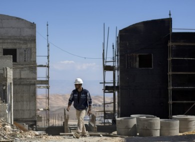 A Palestinian works at a construction site in the Jewish West Bank settlement of Maale Adumim, near Jerusalem