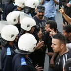 Protesters argue with Moroccan police officers as they break up a demonstration organised by the 20th February, the Moroccan Arab Spring movement in Casablanca, Morocco on 29 May, 2011. (AP Photo/Abdeljalil Bounhar/PA Images)