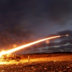 June 2011: Rebel fighters fire a rocket at the front line west of Misrata, Libya. (AP Photo/Hassan Ammar/PA Images)