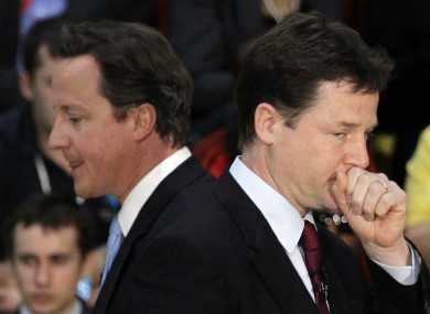 David Cameron (left) and Nick Clegg are deeply divided over the PM's veto at last week's Brussels talks.