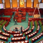 Workers prepare the assembly room where Tunisia's new constituent assembly, elected in the first elections of the Arab Spring, will convene for its first meeting at the end of November. (AP Photo/Hassene Dridi/PA Images)