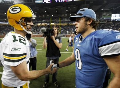Green Bay Packers quarterback Aaron Rodgers (12) and Detroit Lions quarterback Matthew Stafford (9) shake hands after the Packers' Thanksgiving Day win in Detroit.