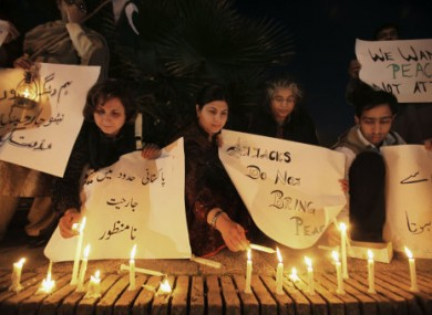 Pakistanis in Islamabad light candles during a protest to condemn the soldiers' killing.