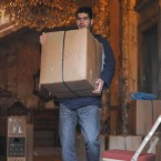 A man carries a box from the residence of the Iranian Charge D'Affaires in Knightsbridge, west London yesterday. (Image: Dominic Lipinski/PA Wire)