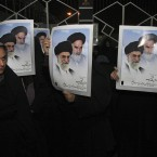 Iranian students hold posters showing supreme leader Ayatollah Ali Khamenei and late revolutionary founder Ayatollah Khomeini during a demonstration to welcome Iranian diplomats expelled from London. (AP Photo/Vahid Salemi/PA Images)