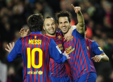 Fabregas celebrates scoring with his Barca teammates.