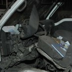 A vehicle damaged by a blast is seen outside the British Embassy compound in Manama, Bahrain, Sunday, Dec. 4, 2011. (AP Photo/Bahrain News Agency) 