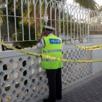 A police officer stands guard outside the British Embassy compound in Manama, Bahrain, Sunday, Dec. 4, 2012. (AP Photo/Hasan Jamali)