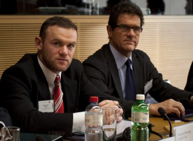 Wayne Rooney and England manager Fabio Capello at this morning's hearing in Nyon.