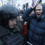 A protester shouts slogans in front of police lines (AP Photo/Mikhail Metzel)