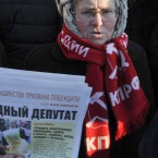 A demonstrator wears a red scarf with the Communist party insignia and a hat reading USSR, in the Siberian city of Novosibirsk (AP Photo/Ilnar Salakhiev)