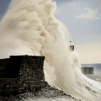Huge waves crash against the harbour wall and engulf the lighthouse at Porthcawl, South Wales (Ben Birchall/PA Wire)