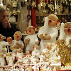 A woman sells Christmas angels at the Christmas market in the city center of Dortmund, Germany (AP Photo/Martin Meissner)