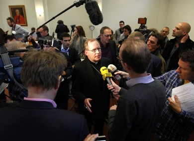 Archbishop of Utrecht Wim Eijk, centre, speaking to reporters after the revelations that up to 20,000 Dutch children were abused by 800 clerical and lay staff in Catholic institutions since 1945.