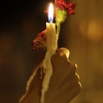A Yemeni girl holds a candle and a flower during a rally to commemorate the first anniversary of Tunisian Mohamed Bouazizi's death – which sparked the so-called Arab Spring. (AP Photo/Hani Mohammed)