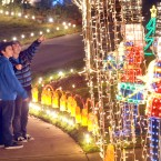 David Reyes, 11 and Tyler Hairston, 12, look at a Christmas lighting in east Medford, Oregan. (AP Photo/The Medford Mail Tribune, Bob Pennell)