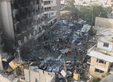 Iraqi security forces gather the scene of a car bomb attack in Baghdad.