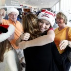 Paige Kinstler, 14, from Florida meets family at Southwest Florida International Airport Thursday, 22 December.