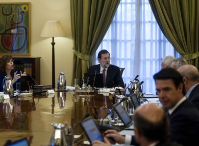 Spain's new Prime Minister Mariano Rajoy, centre, heads the new government's first cabinet meeting at the Moncloa Palace in Madrid, last Friday
