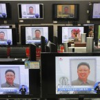 Television screens show North Korean Leader Kim Jong-Il's funeral procession in Seoul, South Korea, Wednesday, Dec. 28, 2011. (AP Photo/Ahn Young-joon)