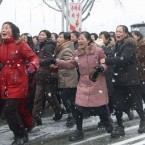 Mourners cry during the funeral procession. (AP PHoto/Kyodo News)