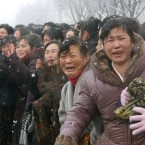 Mourners crying during the funeral procession (AP Photo/Kyodo News)