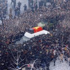 Mourners surround the hearse (AP Photo/Kyodo News)