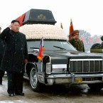 Kim Jong Un, son of the late North Korean leader Kim Jong Il and his successor, salutes beside the hearse carrying the coffin of the elder Kim in Pyongyang on Dec. 28, 2011. The younger Kim's uncle and presumed guardian Jang Song Thaek (behind Kim Jong Un), a vice chairman of the National Defense Commission, and Ri Yong Ho (R), chief of the General Staff of the Korean People's Army, are also in the photo. (Kyodo)