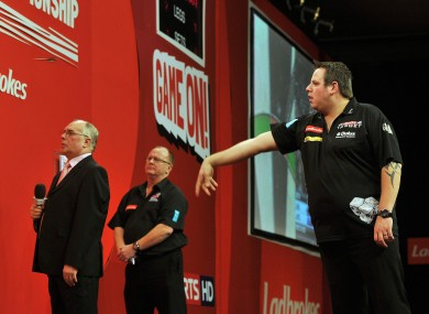 Adrian Lewis in action against Wayne Jones at London's Alexandra Palace last night. Lewis won their last 16 match 4-0.
