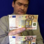 Some forged euro notes and coins that gardai found in shops and pubs around Ireland, pictured on 14 January 2002.