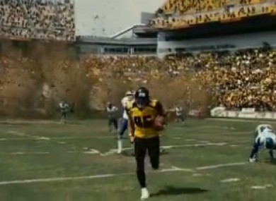 Hines running down the field, which disappears behind him. 