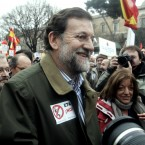The Spanish president hopes to be back on the farm in time to milk the cows later today (AP Photo/Paul White)