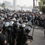 Police and demonstrators square off in Cairo on 25 January, 2011 - the first day of a Tunisia-inspired demonstration demanding President Mubarak's resignation. The #jan25 hashtag spread across Twitter as the protests escalated. Some used social networking sites to arrange where to meet fellow protesters. (AP Photo/PA Images)