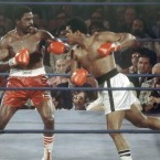 Ai, right, battles Ron Lyle during the 11th round of a heavyweight title bout in Las Vegas in 1975.
