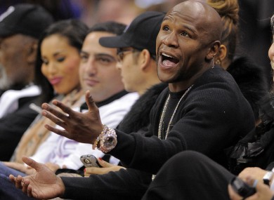 Mayweather talks to a referee as he watches the Los Angeles Clippers' NBA basketball game against the Chicago Bulls last week.