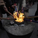 Worshipper burn joss sticks at Jade Temple Shanghai, China (AP Photo/Eugene Hoshiko).