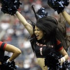 Texan cheerleaders perform before an NFL football game in Houston (AP Photo/David J. Phillip).