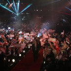 A general view of the arena as Andy Hamilton arrives for his match during the Ladbrokes.com World Darts Championship Final at Alexandra Palace, London.