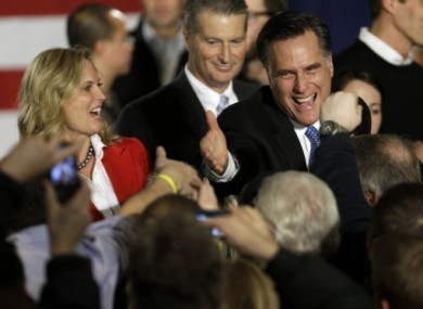 Former Massachusetts Governor Mitt Romney greets supporters during the Iowa caucus.