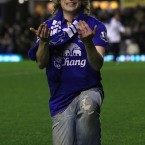 An Everton fan proposes to his girlfriend on the pitch at half-time on Wednesday night. 