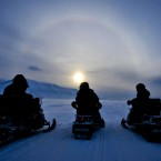 People on ski-doos on the island of Spitsbergen on the Svalbard archipelago in the Arctic circle. (PA)
