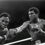 Sweat spray flies from the head of challenger Joe Frazier as heavyweight champion Muhammad Ali connects with a right in the ninth round of their heavyweight title fight in Manila, Philippines. Ali won the fight on a decision to retain the title.